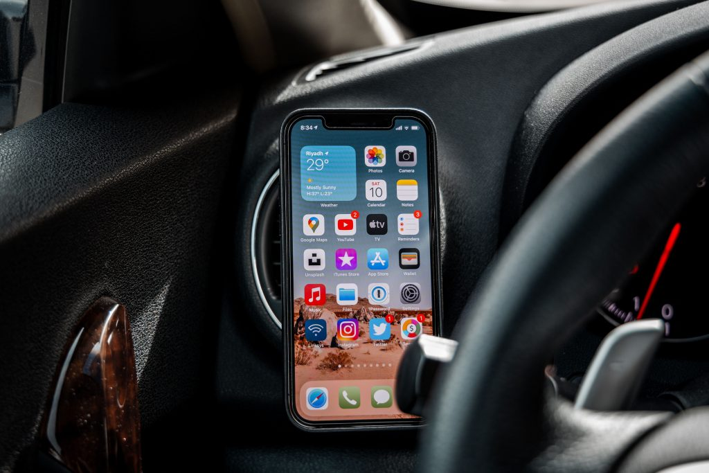 iPhone mounted on a car dashboard.