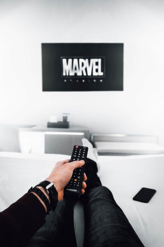 Man watching Marvel on TV.