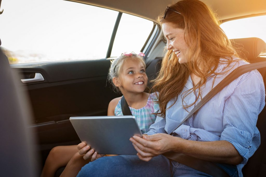 Family using WiFi in a car.