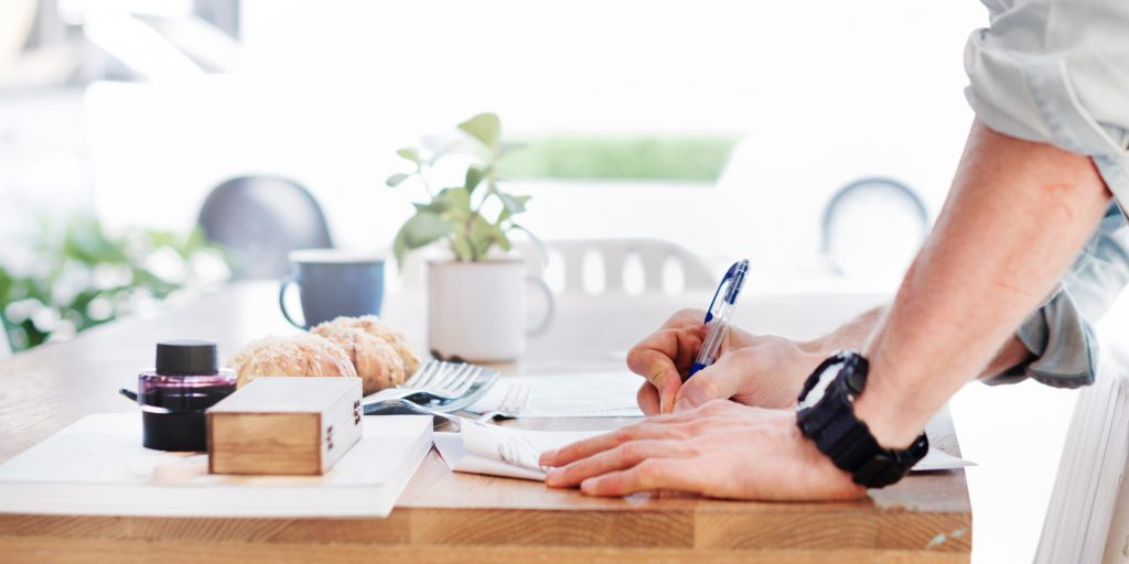 Person signing a contract with a broadband provider.