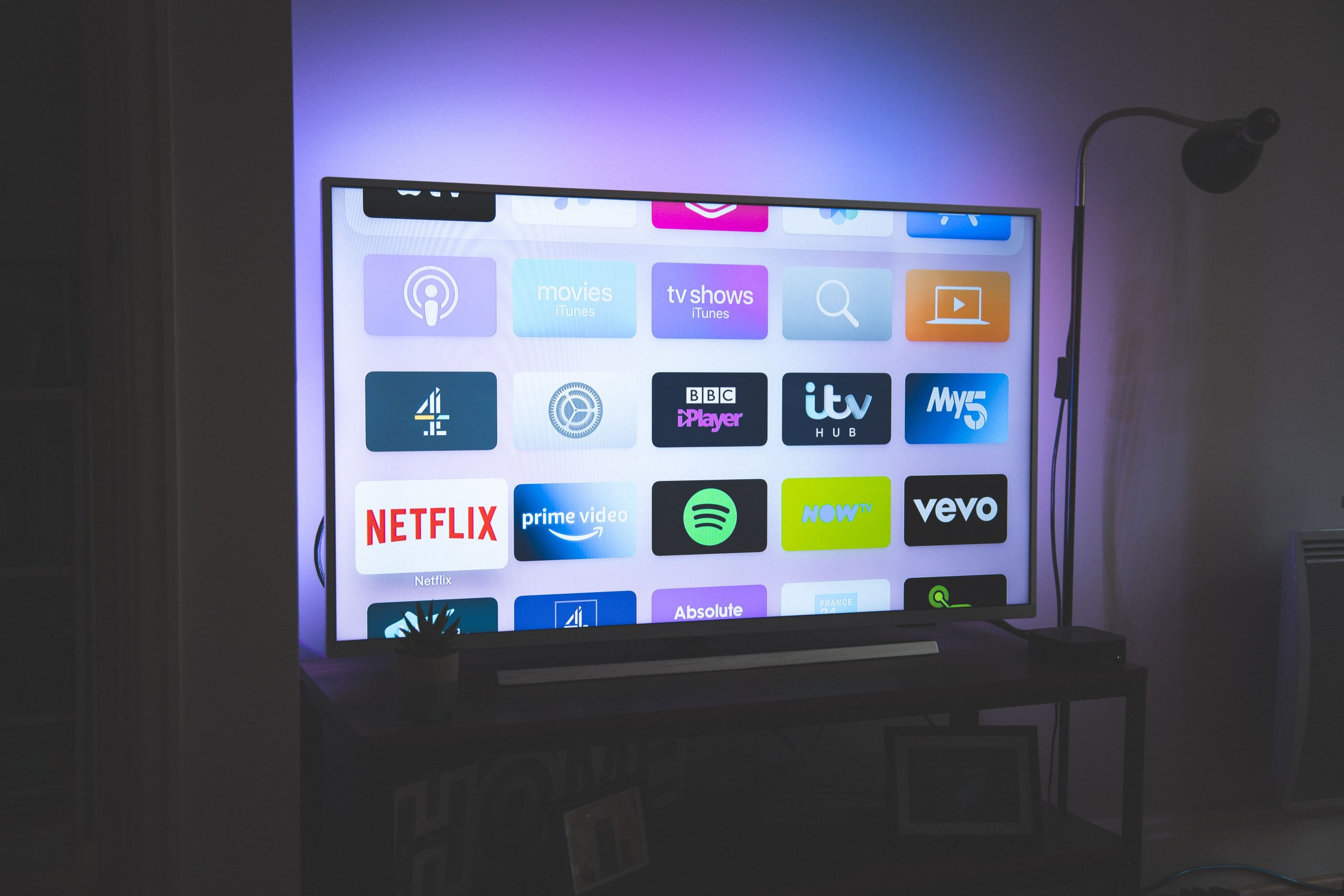A smart TV with a number of TV apps displayed on the screen.