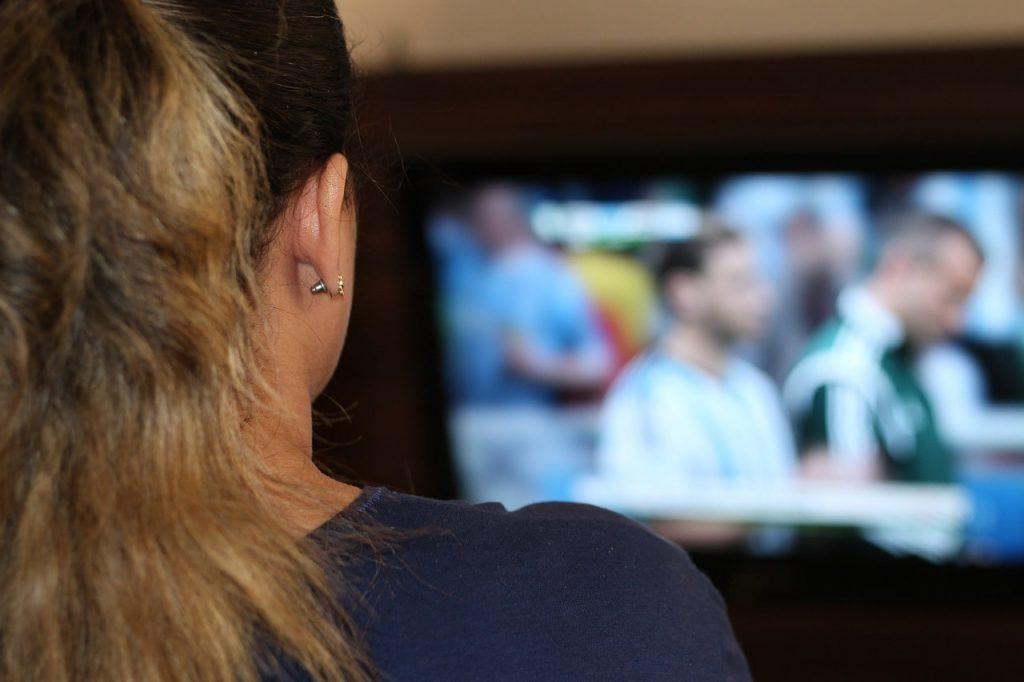 Woman watching TV.